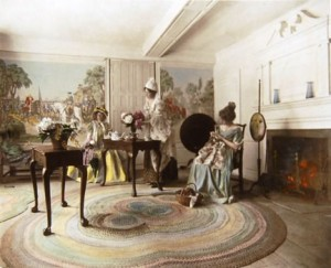 """Birthday Flowers,"" hand-tinted photograph by Wallace Nutting, c. 1916, showing models in colonial dress in the ""Yorktown Parlor"" at the Webb House."