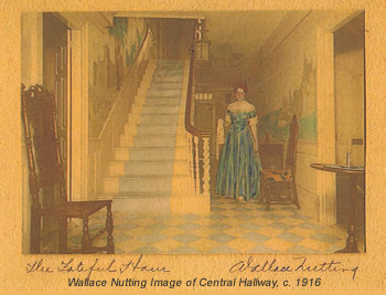 """""""The Fateful Hour"""" (the Center Hall), 1916-19.  W-D-S Collection. The hallway was decorated by Nutting in 1916 with painted murals depicting romanticized views of European castles.  Also note the painted checkerboard pattern on the floor.  The murals were painted over in the 1920s and cannot be restored."""