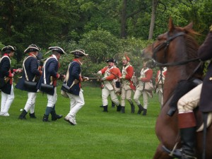 Red coats advancing on members of the 5th Connecticut Regiment during Revolutionary War Encampment at WDS.
